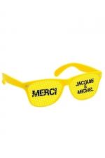 Lunettes jaune jaune - Jacquie & Michel : Lunettes promotionnelles à l'effigie de Jacquie et Michel, le site de sexe amateur incontournable. Monture jaune et verres jaunes.